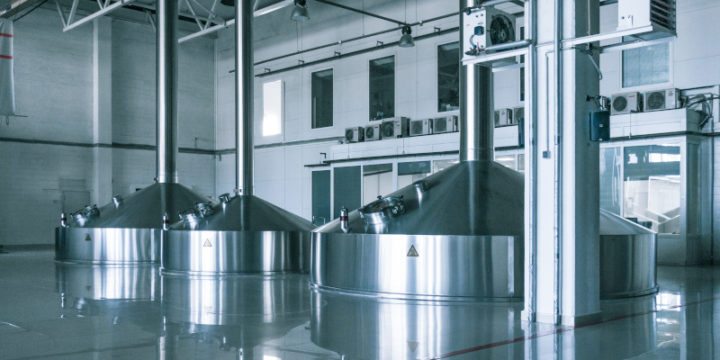 Modern interior of a brewery mash vats metal containers.
